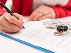 customer signing car loan deal
