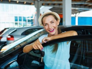 lady smiling after shopping for used cars