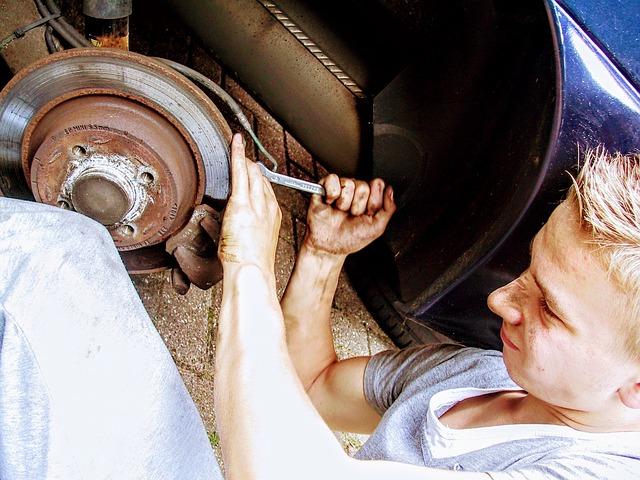 mechanic doing car brake maintenance