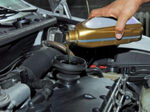 adding car oil